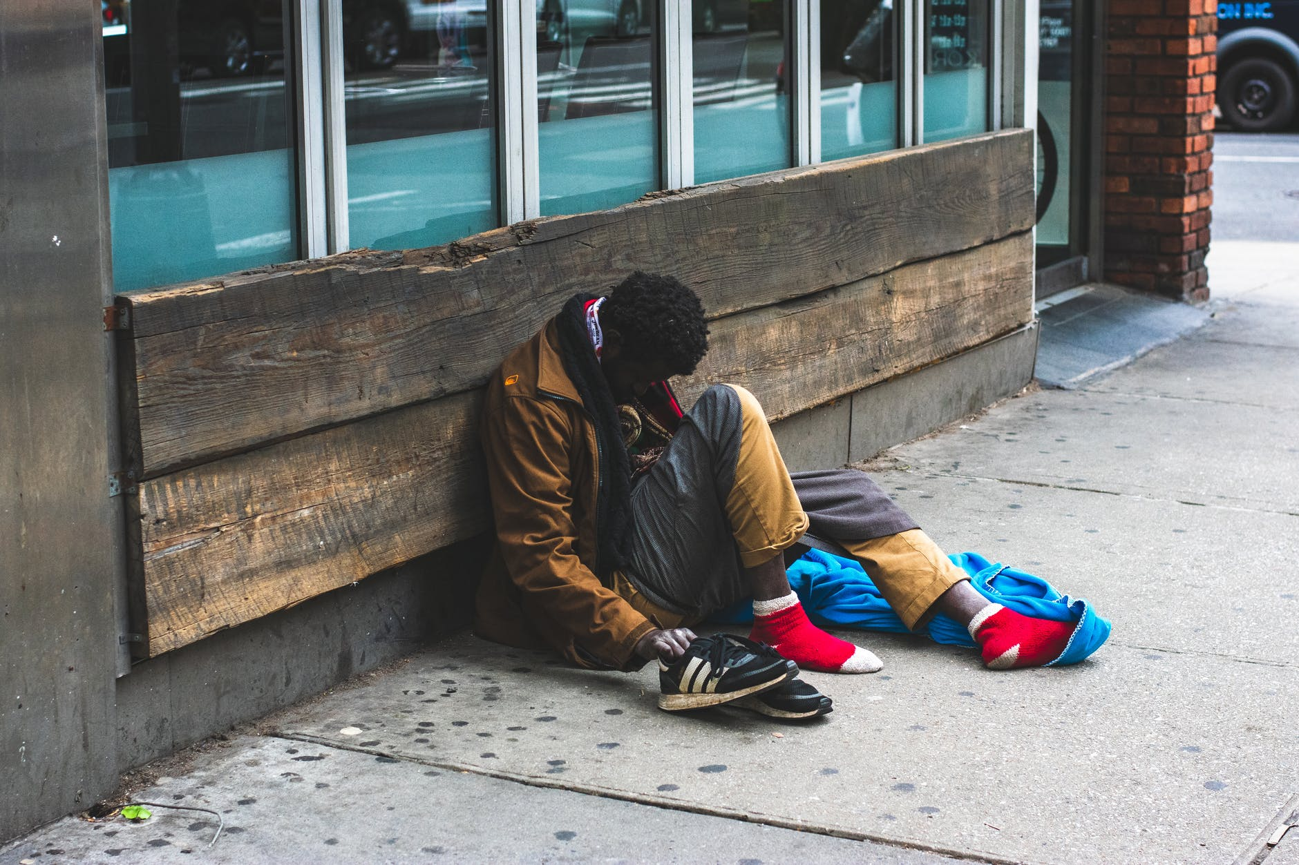 man sitting on street